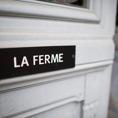 La Ferme Sign on Door